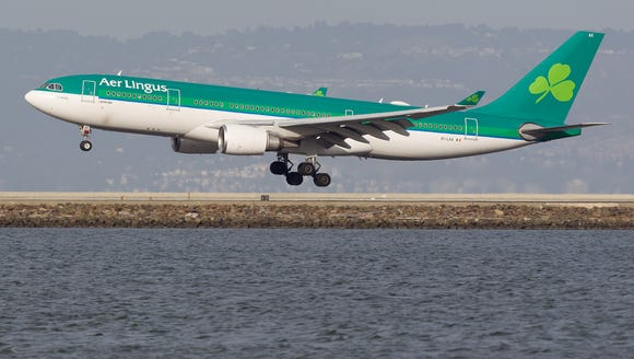 This file photo from Oct. 22, 2016, shows an Aer Lingus Airbus A330 jet landing at San Francisco International Airport.