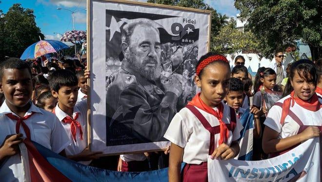 Children pay their last respects to Cuban revolutionary icon Fidel Castro in Bayamo, Granma province, on Nov. 28.