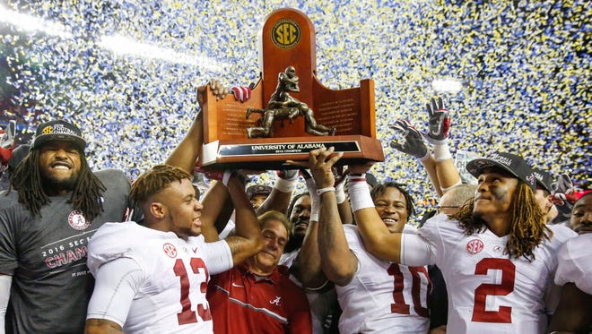 Alabama celebrates with its trophy after winning the SEC title game.