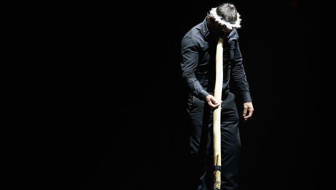 A man plays the didgeridoo in Melbourne, Australia.