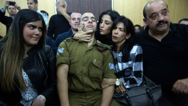 Israeli Sgt. Elor Azaria waits with his parents for the verdict inside a military court in Tel Aviv, Israel, on Jan. 4.
