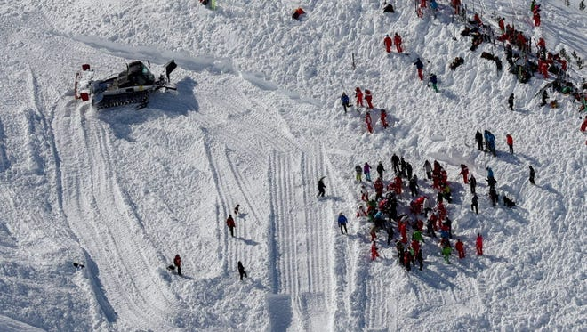An aerial view of rescue crews searching for victims of an avalanche near the French ski resort of Tignes on Feb. 13, 2017.