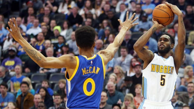 Denver Nuggets guard Will Barton (5) shoots a three-pointer against the Golden State Warriors.