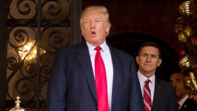 President-elect Donald Trump and National Security Adviser designate Michael Flynn, Dec. 21, 2016, Palm Beach, Fla.