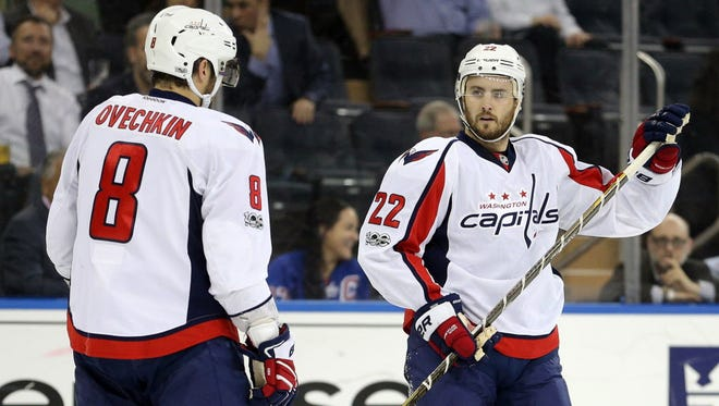 Washington Capitals defenseman Kevin Shattenkirk (22) talks to left wing Alex Ovechkin (8) during the first period against the New York Rangers.