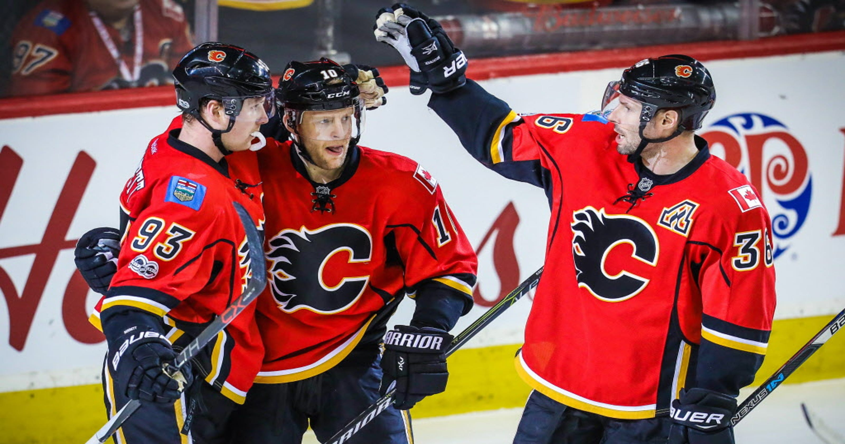 Flames roll past Islanders for seventh straight win 22f2a302f