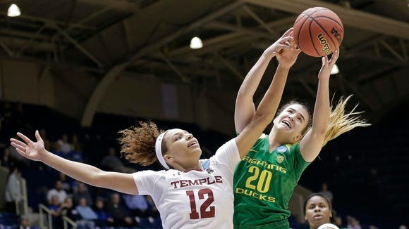 Temple's Ruth Sherrill (12) and Oregon's Sabrina Ionescu (20) reach for a rebound during the first half of a first-round game in the NCAA women's college basketball tournament in Durham, N.C., Saturday, March 18, 2017. (AP Photo/Gerry Broome)
