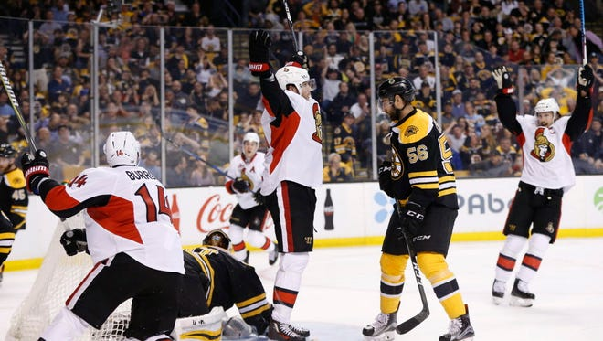 Ottawa Senators forward Bobby Ryan (9) celebrates scoring the winning goal in overtime of Game 3 against the Boston Bruins.