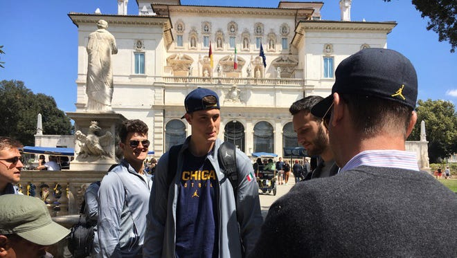 The Michigan football team, including coach Jim Harbaugh to the right, in Rome on April 23, 2017.