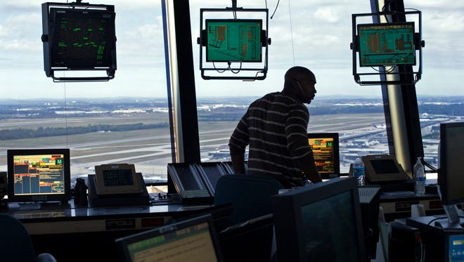 A Federal Aviation Administration air-traffic controller works in the Dulles International Airport tower in Sterling, Va., on Sept. 27, 2016.