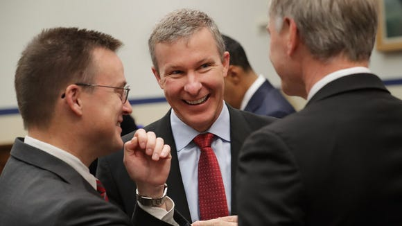 United Airlines President Scott Kirby (C) shares a