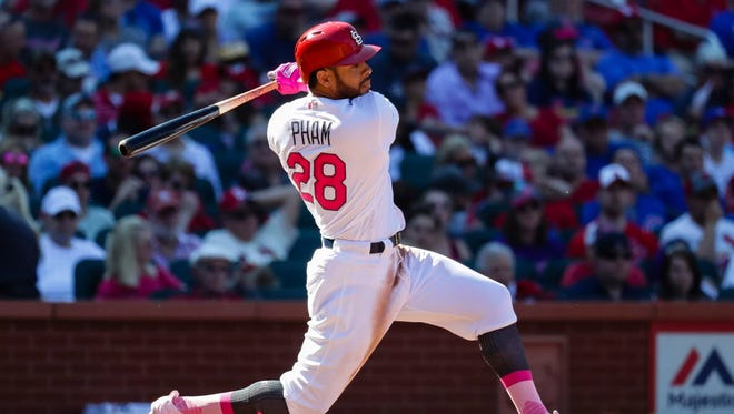 Cardinals' Tommy Pham hits an RBI single to score Yadier Molina during the fourth inning of their game against the Cubs in St. Louis.