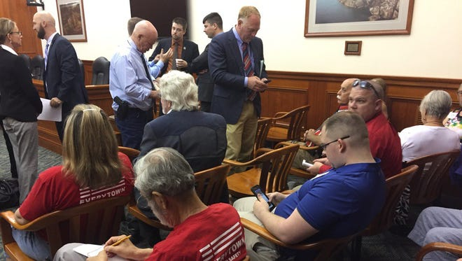 """Large crowds filled the overflow rooms for hearing on bills to make Michigan a """"right to carry"""" state, and to scrap the concealed gun permit."""