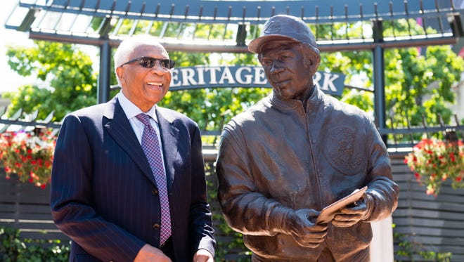 Frank Robinson stands with a new statue at Cleveland's Progressive Field to commemorating his career as the first African-American manager in the major leagues.