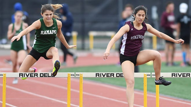 Ridgewood's Katherine Muccio (right) won the 400 intermediate hurdles in North 1, Group 4.