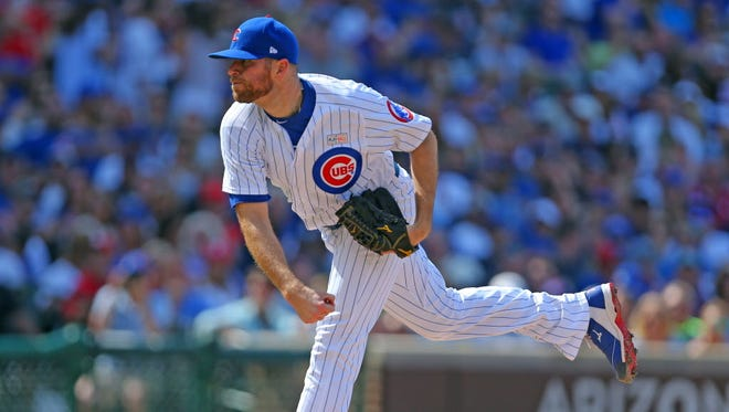 Chicago Cubs relief pitcher Wade Davis (71) is being placed on paternity leave.