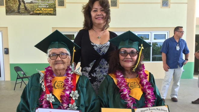 Carmen Iglesias Alconaba, 86, left, and Isabel Iglesias Manibusan, 79, right became Guam's latest World War II survivors to get honorary high school diplomas Friday afternoon. In back is Manibusan's daughter, Anita Lizama.