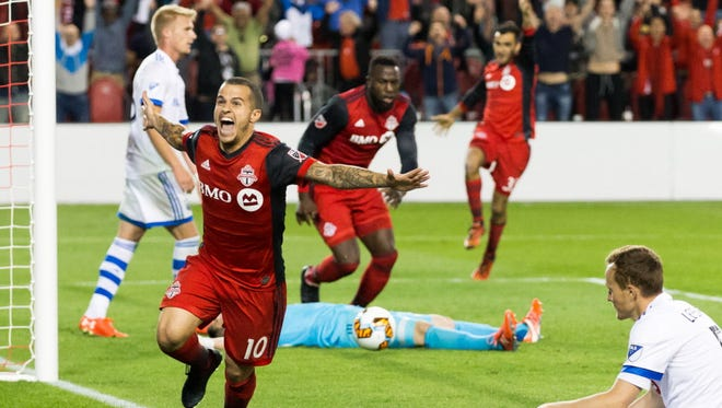Sebastian Giovinco celebrates his winning goal against the Montreal Impact in the Canadian Championship.