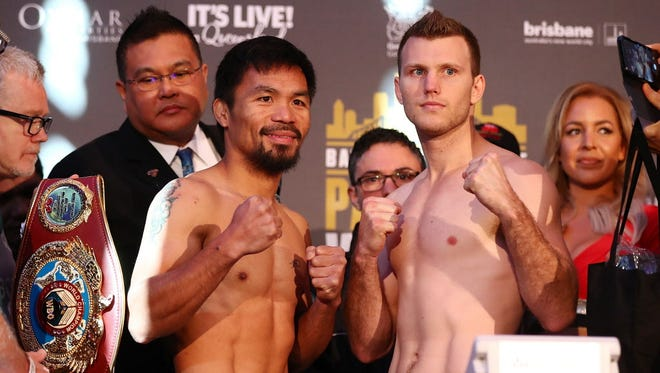 Manny Pacquiao and Jeff Horn face off after the weigh-in ahead of their title fight.