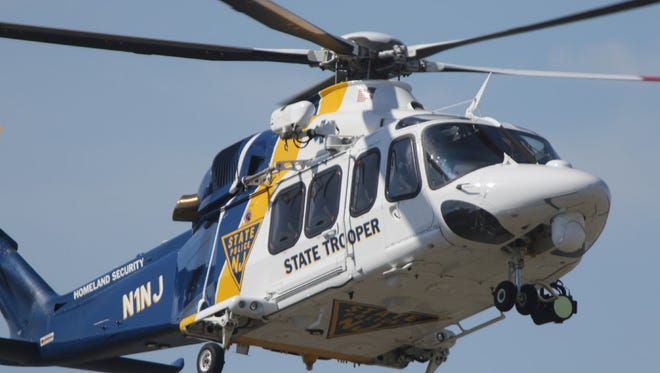 Gov. Chris Christie lands via New Jersey State Police helicopter just before 10 a.m., Monday July 3, 2017.