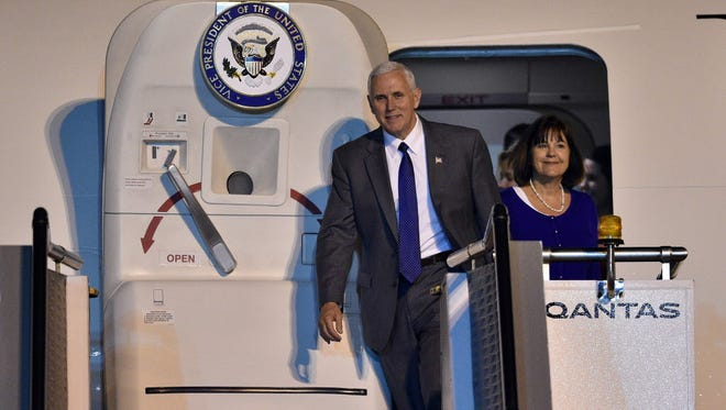 Vice President Mike Pence and his wife Karen exit Air Force Two as they arrive at Sydney airport on April 21, 2017.