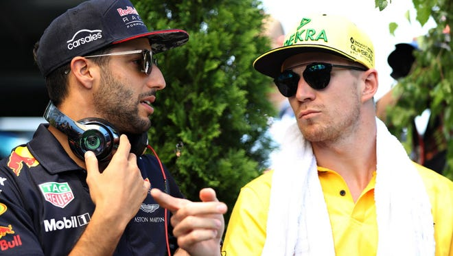 Daniel Ricciardo of Red Bull Racing talks with Nico Hulkenberg of Renault Sport F1 on the drivers' parade before the Formula One Grand Prix of Hungary.