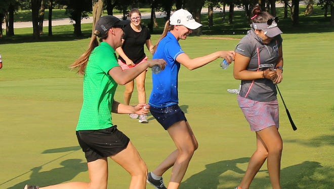 Brittany Marchand (right) gets doused by water after winning the PHC Classic on Sunday at Brown Deer Park Golf Course for her first win on the Symetra Tour.