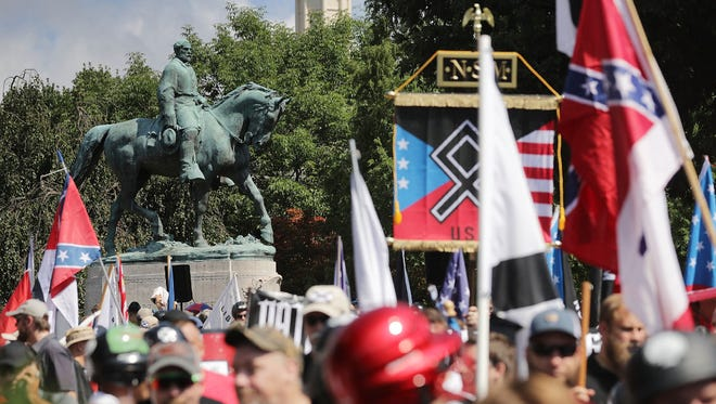 Confederate General Robert E. Lee's statue stands above a crowd of white supremacists in Charlottesville, Va.