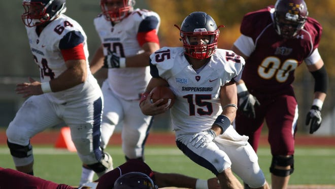 Shippensburg University quarterback Chase Yocum (15) finds a hole against a pair of Bloomsburg defenders during a football game on Saturday, Nov. 5, 2016.