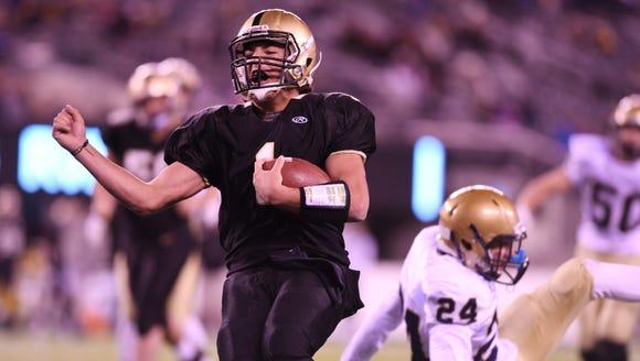 River Dell quarterback David Estevez scores in a 2016