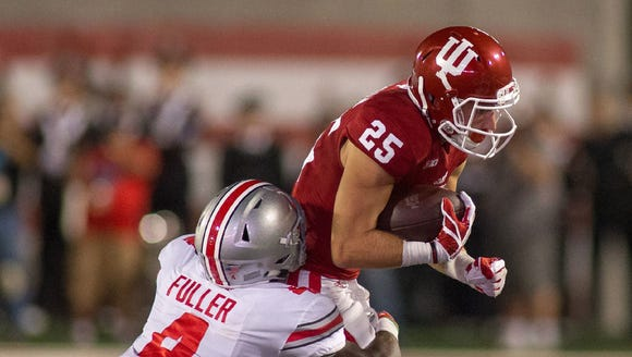Indiana Hoosiers wide receiver Luke Timian (25) rushes