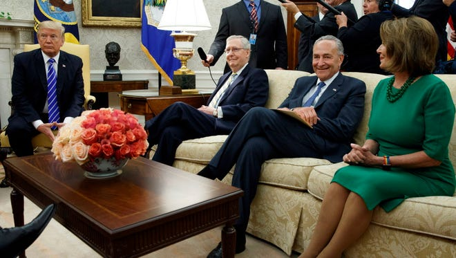 President Trump with Senate Majority Leader Mitch McConnell, Senate Minority Leader Chuck Schumer and House Minority Leader Nancy Pelosi in the Oval Office on Sept. 6, 2017.