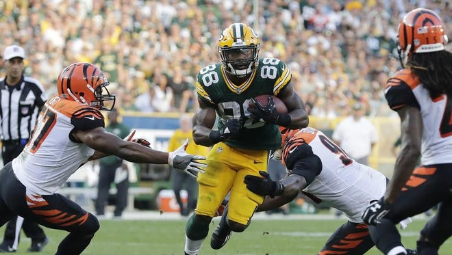 Green Bay Packers running back Ty Montgomery (88) rushes against the Cincinnati Bengals in the third quarter on Sunday, September 24, 2017 at Lambeau Field in Green Bay, Wis.