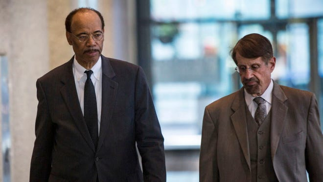 Former U.S. Rep. Mel Reynolds, left, leaves the Dirksen Federal Courthouse in Chicago after a judge convicted Reynolds on charges he failed to file tax returns for income he made while in Africa consulting for Chicago businessmen.