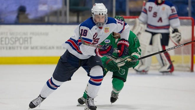 Oliver Wahlstrom (18) chases the puck during a preseason game for the NTDP Under-18s.