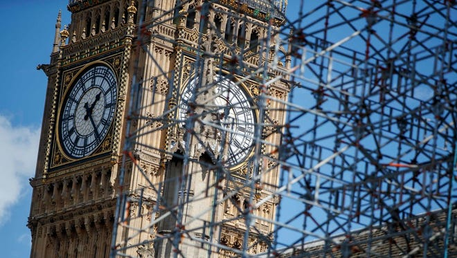 Scaffolding covers part of the Houses of Parliament by the Elizabeth Tower, commonly known as Big Ben in London on Sept. 11.