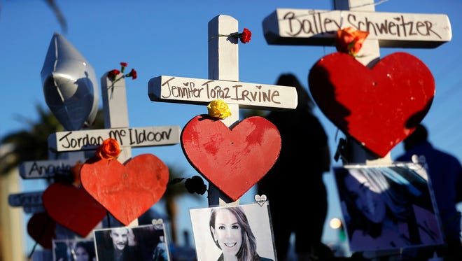 Crosses for victims of the Oct. 1 mass shooting are shown in Las Vegas. A gunman opened fire on an outdoor concert, killing dozens and injuring hundreds.(