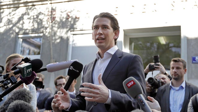 Foreign Minister Sebastian Kurz, head of Austrian People's Party, talks to the media after casting his vote in Vienna, Austria, Sunday, Oct. 15, 2017. He declared victory in Sunday's election and is on the path to become Austria's next chancellor.