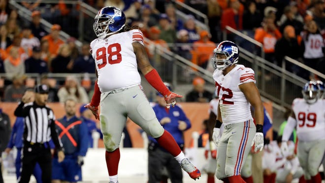 New York Giants defensive tackle Damon Harrison (98) reacts after sacking Denver Broncos quarterback Trevor Siemian during the second half of an NFL football game Sunday, Oct. 15, 2017, in Denver.