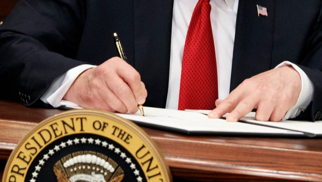 President Trump signs executive order on health care, Roosevelt Room of White House, Washington, Oct. 12, 2017.