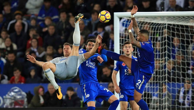 Everton's Phil Jagielka, left, attempts an overhead kick during the match against Leicester in English Premier League action at the King Power Stadium in Leicester, England.