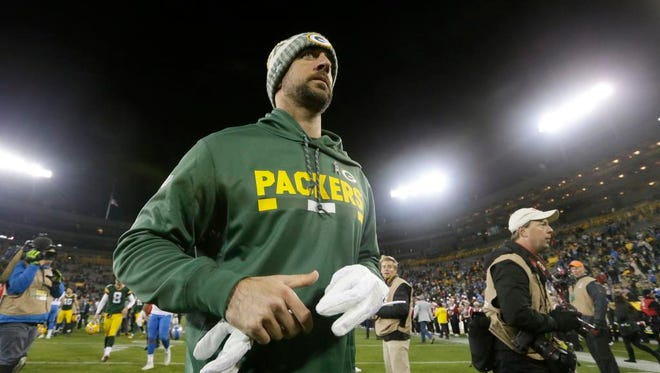 Injured Green Bay Packers quarterback Aaron Rodgers leaves the after their game Monday, November 6, 2017 at Lambeau Field in Green Bay, Wis. The Detroit Lions beat the Green Bay Packers 30-17.