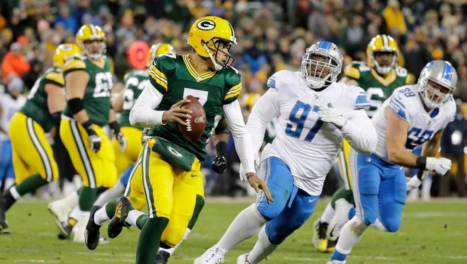 Green Bay Packers quarterback Brett Hundley (7) scrambles away from pressure from Detroit Lions defensive tackle Akeem Spence (97) in the fourth quarter at Lambeau Field on Monday, November 6, 2017 in Green Bay, Wis.