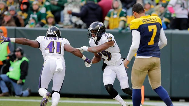 Baltimore Ravens defensive back Marlon Humphrey (29) celebrates after an interception against the Green Bay Packers in the fourth quarter at Lambeau Field on Sunday, November 19, 2017 in Green Bay, Wis.