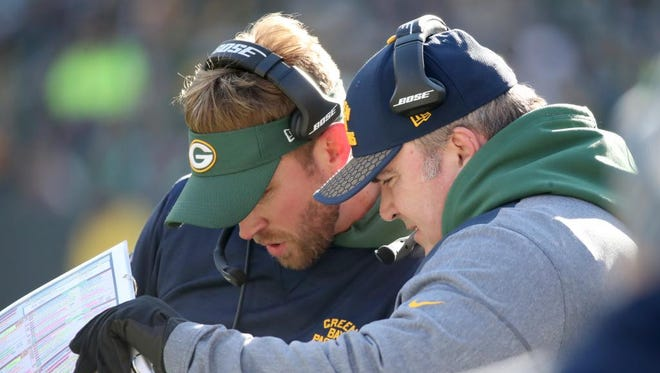 Packers head coach Mike McCarthy on the sidelines with offensive permitter coach David Raih against the Baltimore Ravens Sunday, November 19, 2017 at Lambeau Field in Green Bay, Wis.