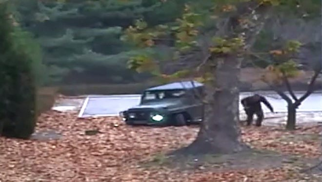 A screengrab from video footage released by the United Nations Command shows a North Korean defector running out from a vehicle at the Joint Security Area of the Demilitarized Zone (DMZ).