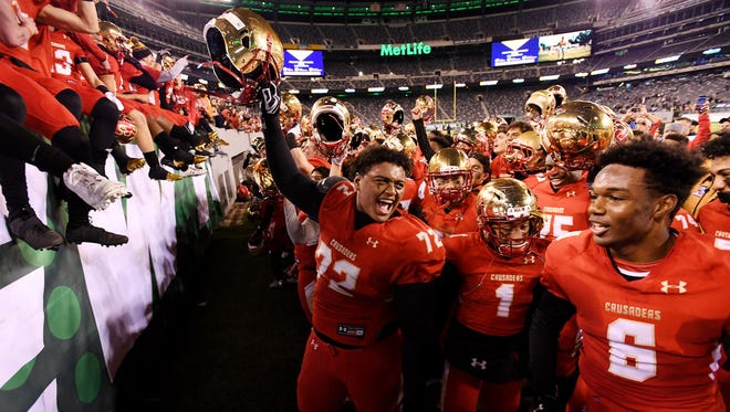 Bergen Catholic players celebrating after winning their first state title since 2004.