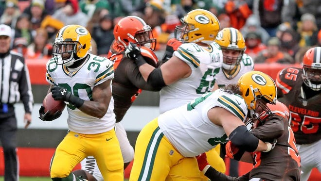 Green Bay Packers running back Jamaal Williams (30) runs through blockers David Bakhtiari (69) and Corey Linsley (63) against the Cleveland Browns on Dec. 10, 2017 at FirstEnergy Stadium in Cleveland.