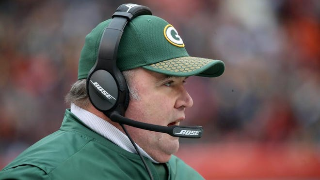 Green Bay Packers head coach Mike McCarthy calls a play from the sidelines against the Cleveland Browns on Dec. 10, 2017 at FirstEnergy Stadium in Cleveland.