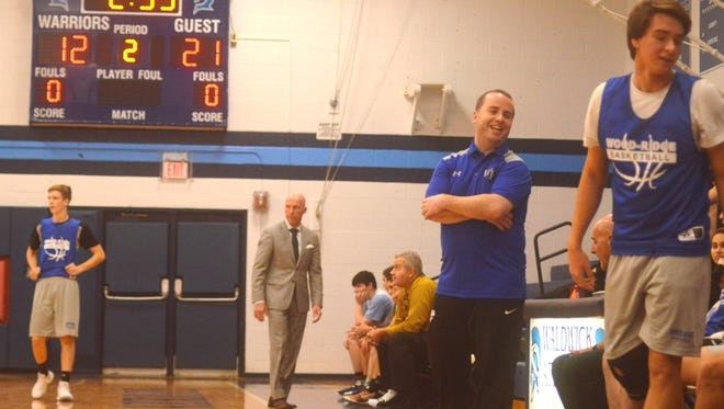 New Wood-Ridge coach Jimmy Maher (center) with former Blue Devils coach Eddie Rendzio (background in suit) now coaching Waldwick.